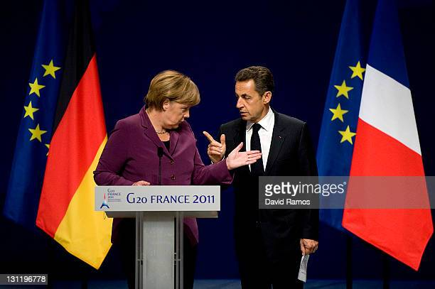 German Chancellor Angela Merkel and French President Nicolas Sarkozy talk as they arrive for a press conference after a meeting with Greek Prime...