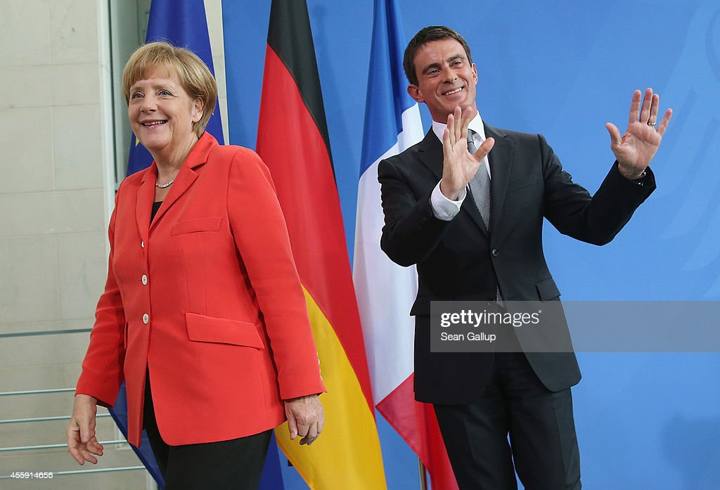 German Chancellor Angela Merkel and French Prime Minister Manuel Valls depart after speaking to the media following talks at the Chancellery on September 22, 2014 in Berlin, Germany. Valls is on a two-day visit to Germany at a time when Merkel has been critical of the slow pace of French economic reforms.