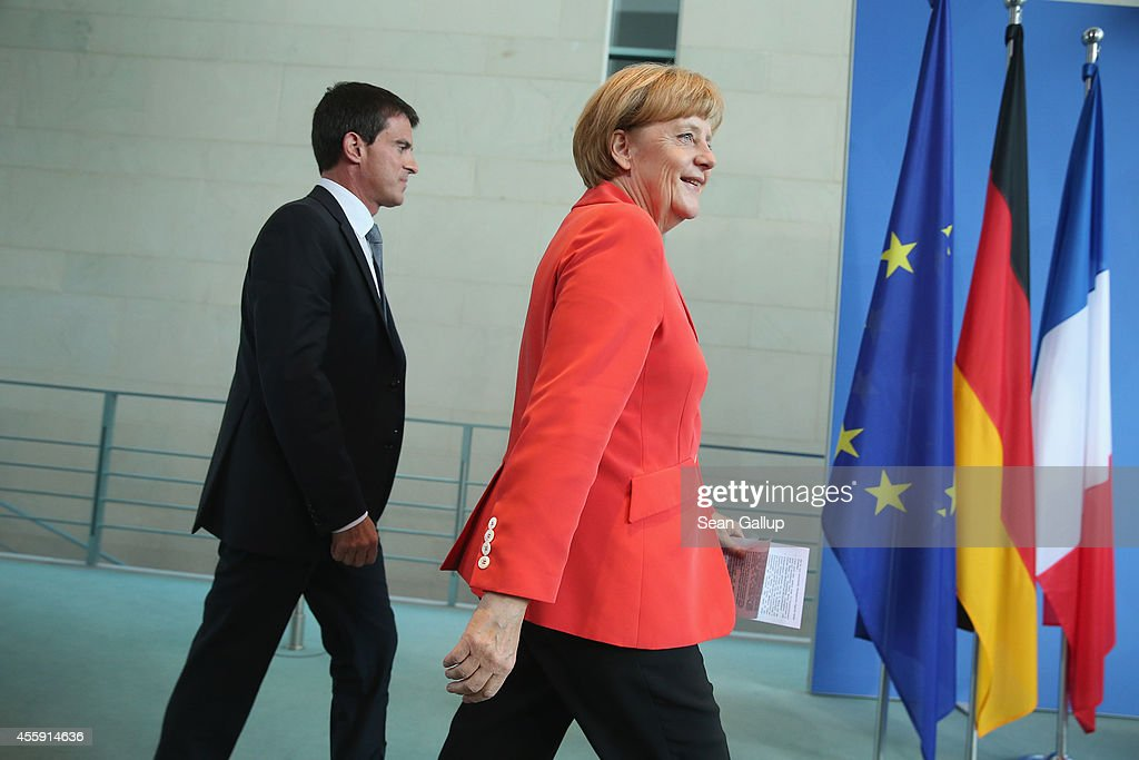 German Chancellor Angela Merkel and French Prime Minister Manuel Valls arrive to speak to the media following talks at the Chancellery on September 22, 2014 in Berlin, Germany. Valls is on a two-day visit to Germany at a time when Merkel has been critical of the slow pace of French economic reforms.