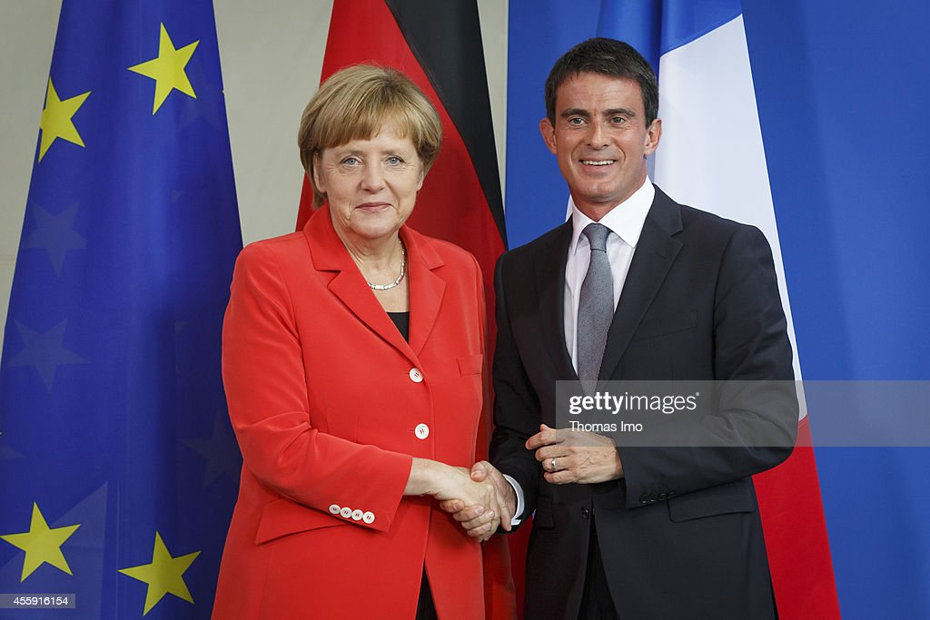 German Chancellor Angela Merkel and French Prime Minister Manuel Valls speak to the media following talks at the Chancellery on September 22, 2014 in Berlin, Germany. Valls is on a two-day visit to Germany at a time when Merkel has been critical of the slow pace of French economic reforms.