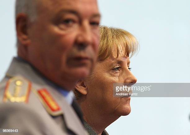German Chancellor Angela Merkel and General lieutenant Rainer Glatz of the German military, the Bundeswehr, attend a press conference after a meeting...
