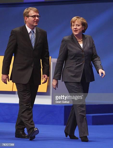 German Chancellor Angela Merkel and German Christian Democratic Union General Secretary Ronald Pofalla take a brief walk through the site of the...