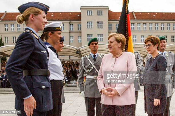 German Chancellor Angela Merkel and German Defence Minister Annegret KrampKarrenbauer talk to soldiers during an oathtaking ceremony of the German...