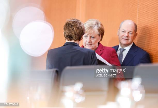 German Chancellor Angela Merkel and German Defence Minister Annegret KrampKarrenbauer chat as German Finance Minister and ViceChancellor Olaf Scholz...
