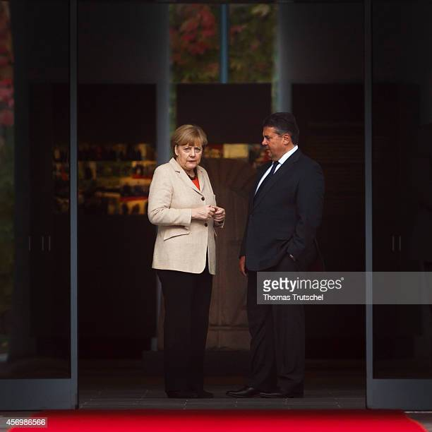 German Chancellor Angela Merkel and German Economy Minister and Vice Chancellor Sigmar Gabriel waits for the arrival of Chinese Premier Li Keqiang at...