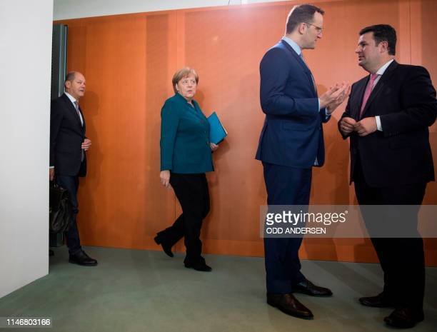 German Chancellor Angela Merkel and German Finance Minister and ViceChancellor Olaf Scholz arrive for the weekly cabinet meeting as German Health...