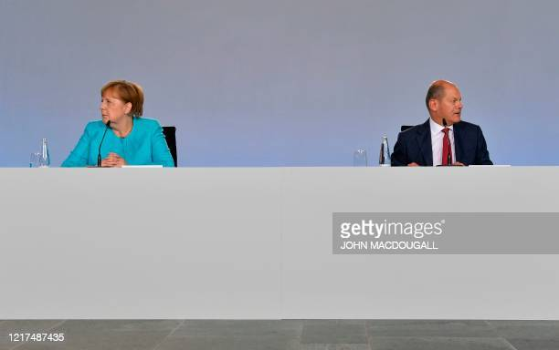 German Chancellor Angela Merkel and German Finance Minister and ViceChancellor Olaf Scholz address a press conference on late June 3 2020 at the...