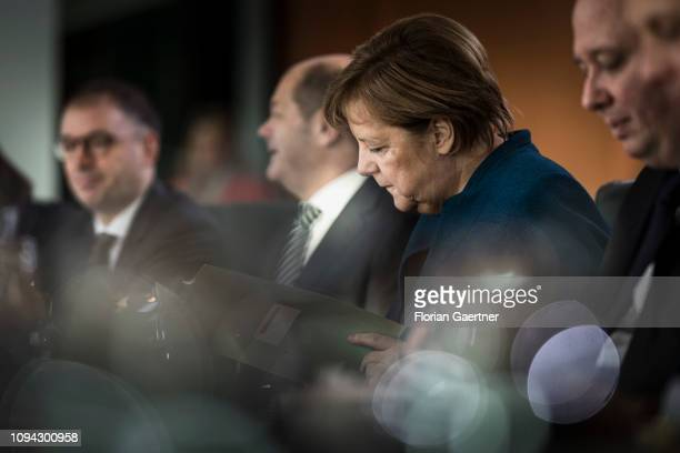 German Chancellor Angela Merkel and German Finance Minister Olaf Scholz are pictured before the weekly cabinet meeting of the Federal Government on...