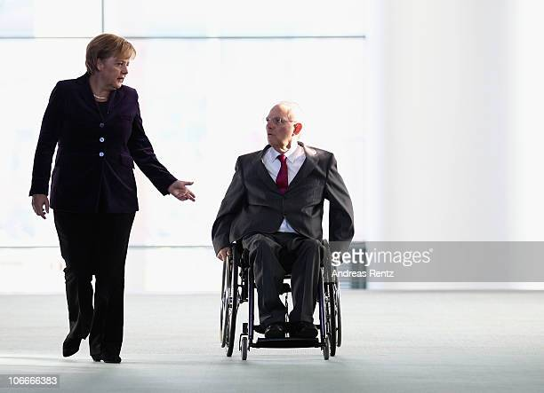 German Chancellor Angela Merkel and German Finance Minister Wolfgang Schaeuble arrive for a press conference at the Chancellery on November 10 2010...