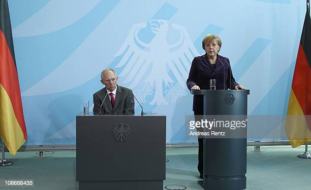 German Chancellor Angela Merkel and German Finance Minister Wolfgang Schaeuble attend a press conference at the Chancellery on November 10 2010 in...