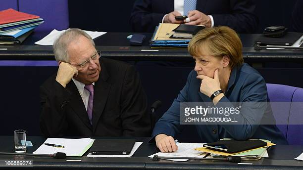 German Chancellor Angela Merkel and German Finance Minister Wolfgang Schaeuble react after the result of the a bailout package for debtmired Cyprus...
