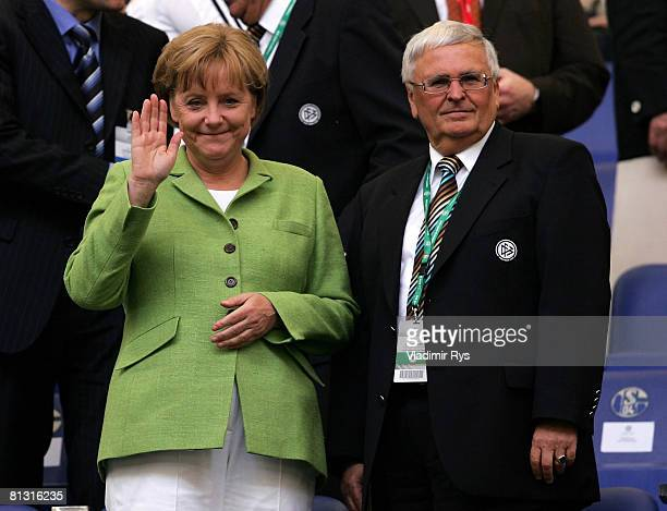 German Chancellor Angela Merkel and German Football Association President Theo Zwanziger look on from the stands prior to the German international...