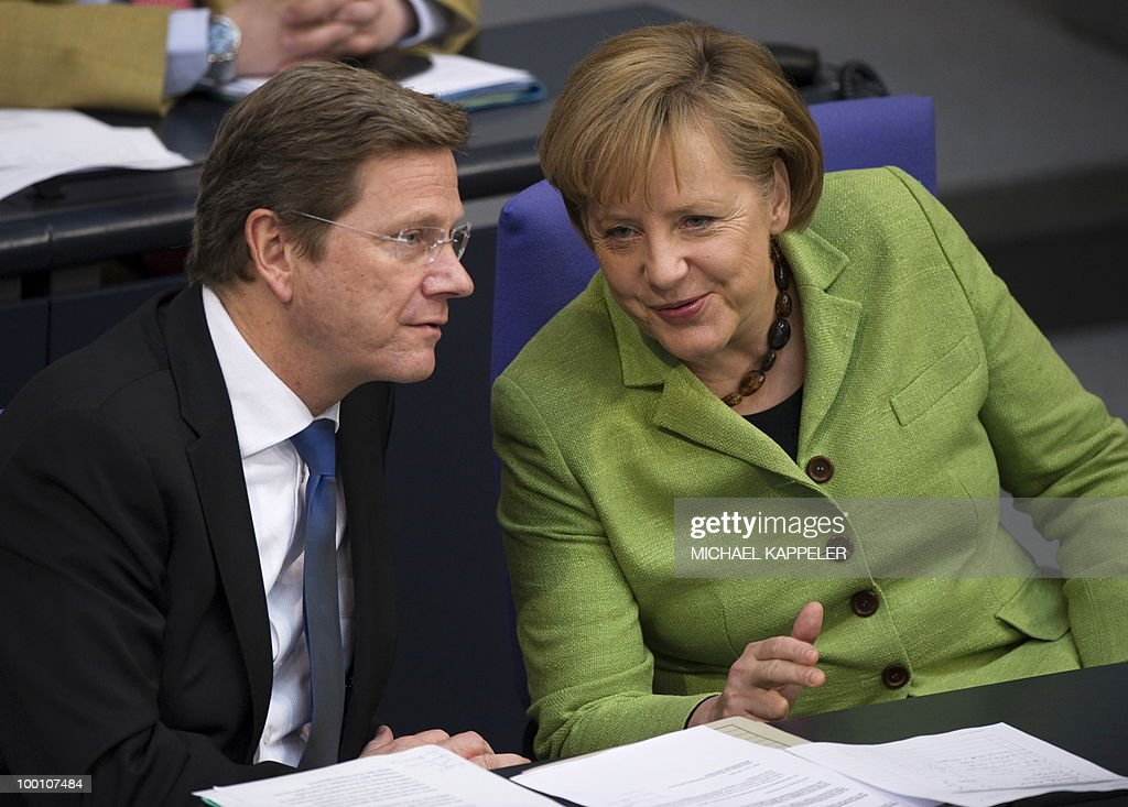 German Chancellor Angela Merkel and German Foreign minister Guido Westerwelle attend a debate at the Bundestag, the lower house of parliament, on May 21, 2010 in Berlin. The German parliament is set to unblock its share of a trillion-dollar rescue package for debt-stricken eurozone countries , after Chancellor Angela Merkel warned the euro was 'in danger'.