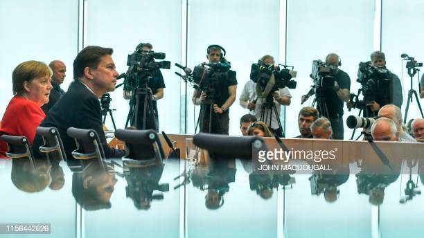 German Chancellor Angela Merkel and German government spokesman Steffen Seibert attend the summer press conference in Berlin on July 19 2019
