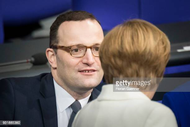 German Chancellor Angela Merkel and German Health Minister Jens Spahn are pictured before the swearingin ceremony of the new federal government on...