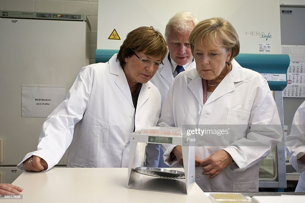 German Chancellor Angela Merkel (R) And German Health Minister Ulla Schmidt  Visit Together With Design