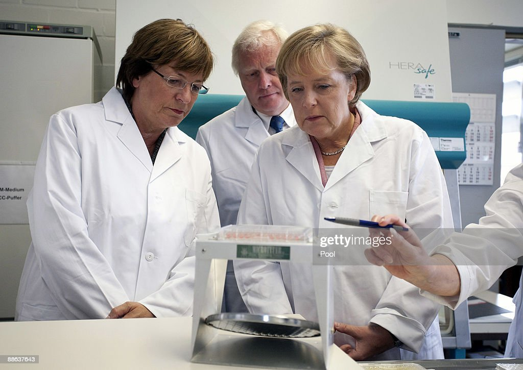 Awesome German Chancellor Angela Merkel (R) And German Health Minister Ulla Schmidt  Visit Together With