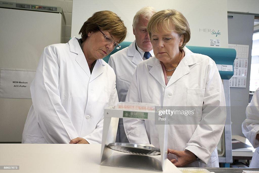 German Chancellor Angela Merkel (R) And German Health Minister Ulla Schmidt  Visit Together With Design Inspirations