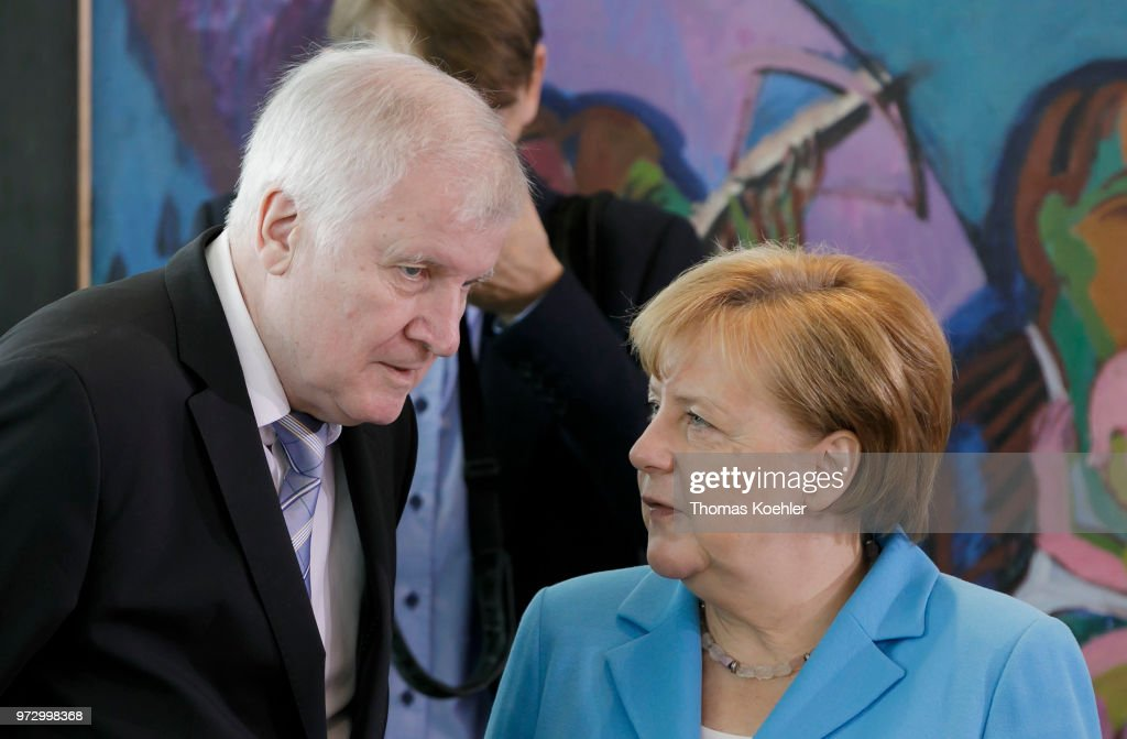 German Chancellor Angela Merkel (R) and German Interior Minister Horst Seehofer (L) before the Weekly Government Cabinet Meeting on June 13, 2018 in Berlin, Germany.