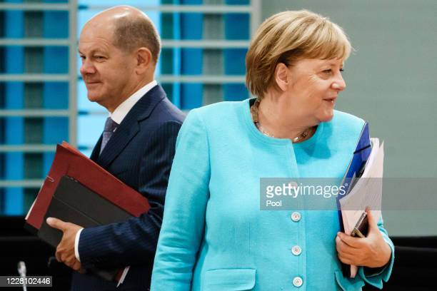 German Chancellor Angela Merkel and German Minister of Finance Olaf Scholz attend a cabinet meeting at the German chancellery on August 19, 2020 in...