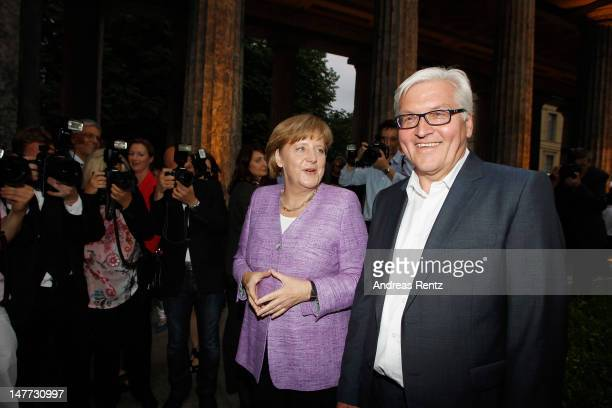 German Chancellor Angela Merkel and German politican FrankWalter Steinmeier attend the ZDF summer reception on July 2 2012 in Berlin Germany