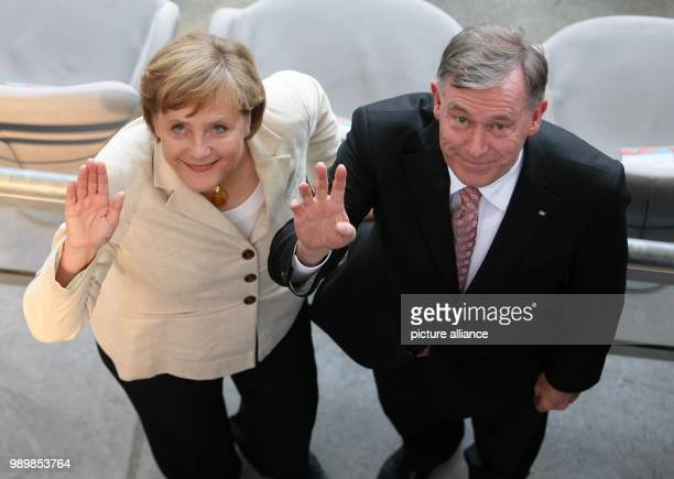 German Chancellor Angela Merkel and German President Horst Koehler waving before opening group A match of 2006 FIFA World Cup between Germany and...