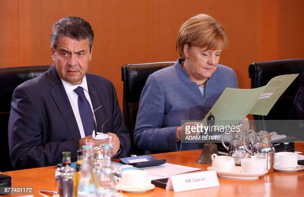 German Chancellor Angela Merkel and German Vice Chancellor and Foreign Minister Sigmar Gabriel wait for the start of the weekly cabinet meeting in...