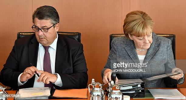 German Chancellor Angela Merkel and German Vice Chancellor Economy and Energy Minister Sigmar Gabriel attend a weekly meeting of the German cabinet...