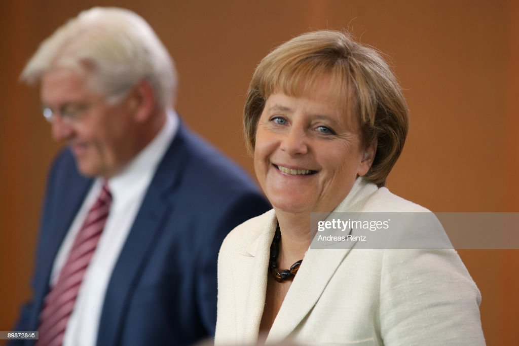 German Chancellor Angela Merkel and German Vice-Chancellor and Foreign Minister Frank-Walter Steinmeier arrive for the weekly German government cabinet meeting at the Chancellery on August 19, 2009 in Berlin, Germany. High on the morning's agenda was the obligation of the statutory health insurance of the new vaccinations against influenza A(H1N1), so called swine flu.
