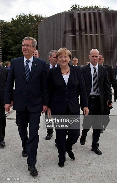 German Chancellor Angela Merkel and Germany's President Christian Wulff arrive for a commemorative ceremony of the construction of the Berlin Wall at...