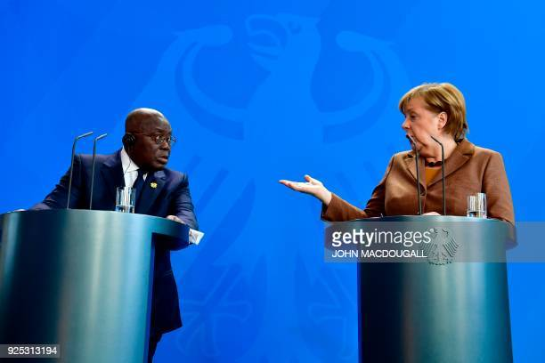 German Chancellor Angela Merkel and Ghana's President Nana AkufoAddo give a joint press conference after a meeting on February 28 2018 in Berlin /...