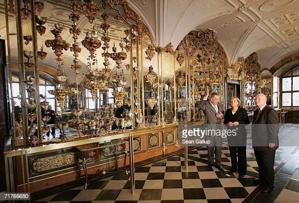 German Chancellor Angela Merkel and Governor of Saxony Georg Milbradt tour exhibits at the Gruenes Gewoelbe Museum with museum director Dirk Syndram...