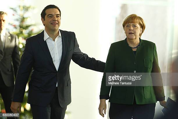 German Chancellor Angela Merkel and Greek Prime Minister Alexis Tsipras arrive to speak to the media prior to talks at the Chancellery on December 16...