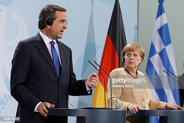 German Chancellor Angela Merkel and Greek Prime Minister Antonis Samaras speak during a press statement at the Chancellery on August 24 2012 in...