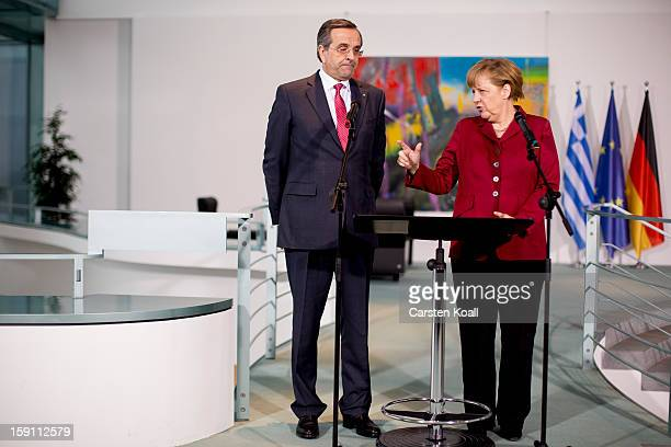 German Chancellor Angela Merkel and Greek Prime Minister Antonis Samaras give statements to the media following a meeting between the two leaders at...