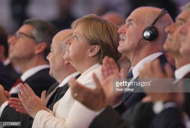 German Chancellor Angela Merkel and Greek Prime Minister George Papandreou attend a convention of the Federation of German Industry where Papandreou...