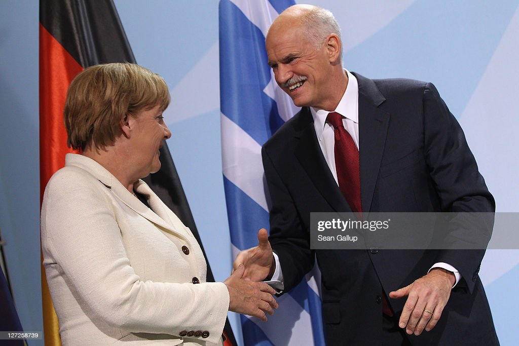German Chancellor Angela Merkel and Greek Prime Minister George Papandreou depart after speaking to the media prior to talks at the Chancellery on September 27, 2011 in Berlin, Germany. The two leaders are meeting to discuss the current Greek debt crisis that is threatening the stability of the Euro two days before the Bundestag is scheduled to vote on an increase in funding for the European Financial Stability Facility (EFSF).