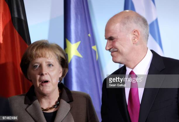 German Chancellor Angela Merkel and Greek Prime Minister George Papandreou depart after speaking to the media fllowing talks at the Chancellery on...