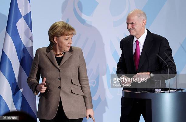 German Chancellor Angela Merkel and Greek Prime Minister George Papandreou depart after speaking to the media following talks at the Chancellery on...