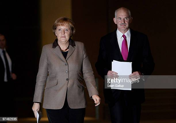 German Chancellor Angela Merkel and Greek Prime Minister George Papandreou arrive to speak to the media after talks at the Chancellery on March 5...