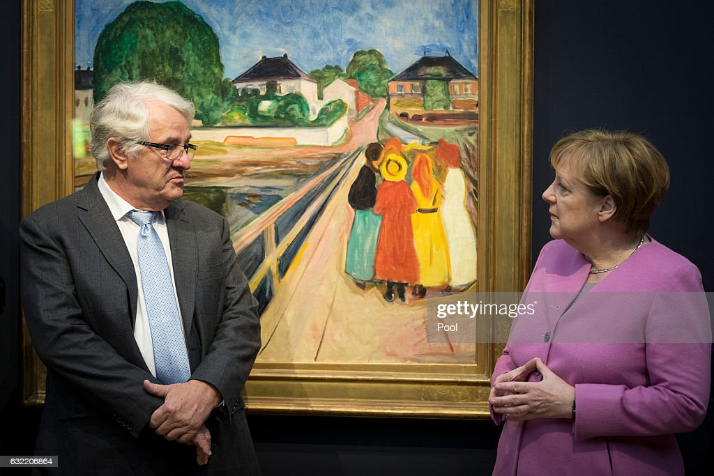 German Chancellor Angela Merkel (R) and Hasso Plattner view the painting 'Girls on the Bridge' by Edward Munch during the official opening of the Barberini Museum on January 20, 2017 in Potsdam, Germany. The Barberini, patronized by billionaire Hasso Plattner, features works by Monet, Renoir and Caillebotte among others.