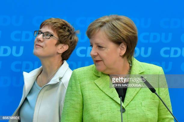 German Chancellor Angela Merkel and her conservative Christian Democratic Union party's top candidate for regional elections in the southwestern...