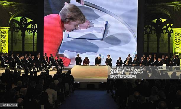 German Chancellor Angela Merkel and her Foreign Minister FrankWalter Steinmeier sign a landmark EU treaty 13 December 2007 in Jeronimos monastery in...
