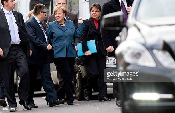 German Chancellor Angela Merkel and her head of office Beate Baumann arrive for negotiations between the German Social Democrats German Christian...