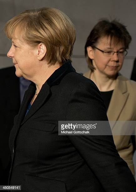 German Chancellor Angela Merkel and her head of office in German Chancellory Beate Baumann arrive for another round of coalition negotiations with...