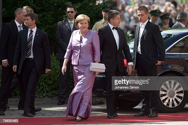 German Chancellor Angela Merkel and her husband Joachim Sauer 2 arrive for the premiere of the Richard Wagner festival on July 25 2007 in Bayreuth...