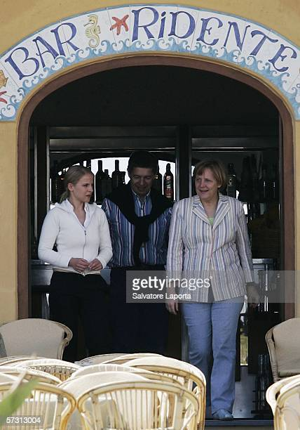 German Chancellor Angela Merkel and her husband Joachim Sauer are seen as they walk through the streets of Sant'Angelo on April 11 2006 whilst...