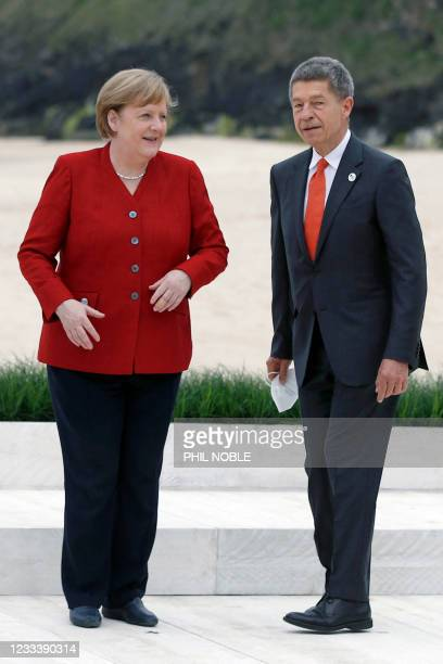 German Chancellor Angela Merkel and her husband Joachim Sauer arrive for the G7 summit in Carbis Bay, Cornwall, on June 11, 2021.