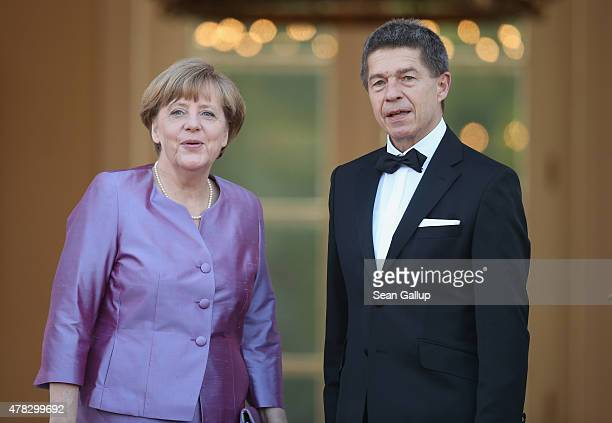 German Chancellor Angela Merkel and her husband Joachim Sauer arrive for the state banquet in honour of Queen Elizabeth II at Schloss Bellevue palace...