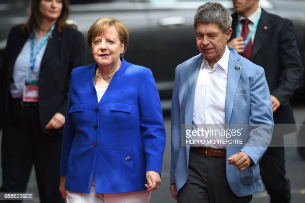 German Chancellor Angela Merkel and her husband Joachim Sauer arrive for the Summit of the Heads of State and of Government of the G7 the group of...